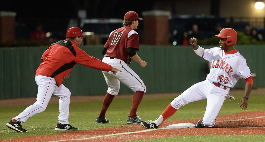 Lamar's C. J. Moore slides into third base ahead of the throw during the Cardinals' home opener against New Mexico State Friday night at Vincent Beck Stadium. Photo taken Friday, February 13, 2015 Kim Brent/The Enterprise Photo: Kim Brent / Beaumont Enterprise