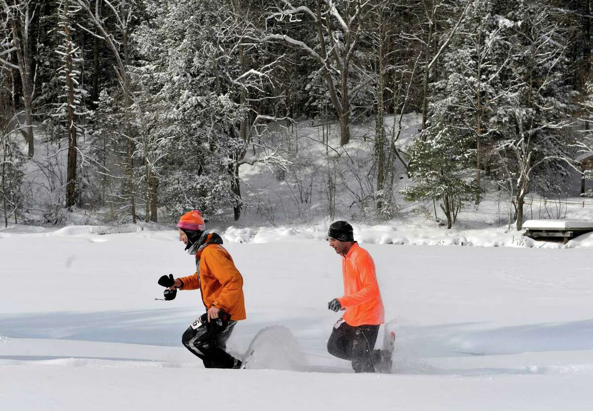 Racers make their way along the course during the 12th Annual Camp Saratoga 8k Snowshoe Race on Sunday, Feb. 15, 2015, in Wilton, N.Y. The race is a U.S. National Snowshoe Championships qualifier. (Paul Buckowski / Times Union)