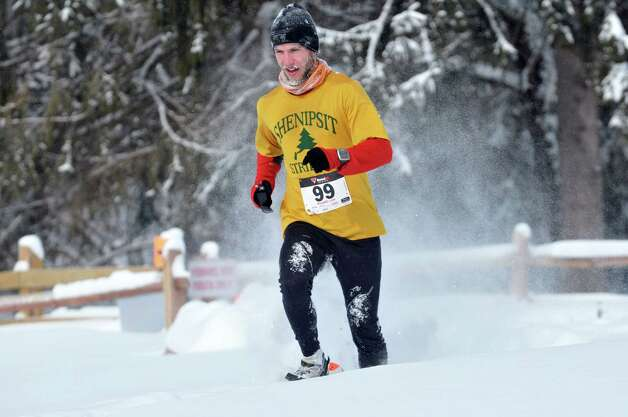 Dave Merkt of Manchester, VT, comes in for a second place finish in the 12th Annual Camp Saratoga 8k Snowshoe Race on Sunday, Feb. 15, 2015, in Wilton, N.Y.  The race is a U.S. National Snowshoe Championships qualifier.   (Paul Buckowski / Times Union) Photo: Paul Buckowski / 00030550A