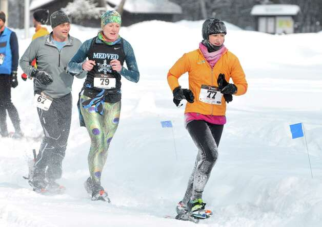 Racers make their way along the course during the 12th Annual Camp Saratoga 8k Snowshoe Race on Sunday, Feb. 15, 2015, in Wilton, N.Y.  The race is a U.S. National Snowshoe Championships qualifier.   (Paul Buckowski / Times Union) Photo: Paul Buckowski / 00030550A