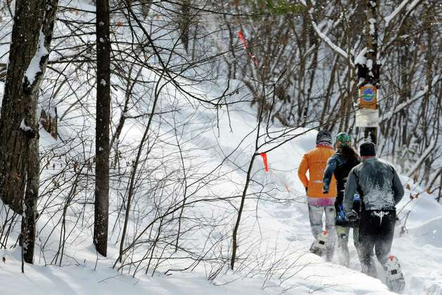 A group of racers start to ascend a hill during the 12th Annual Camp Saratoga 8k Snowshoe Race on Sunday, Feb. 15, 2015, in Wilton, N.Y.  The race is a U.S. National Snowshoe Championships qualifier.   (Paul Buckowski / Times Union) Photo: Paul Buckowski / 00030550A