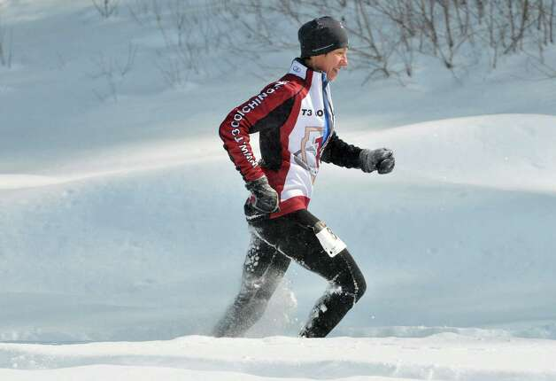 Mara Fronhofer of Fort Edward makes her way towards the finish line during the 12th Annual Camp Saratoga 8k Snowshoe Race on Sunday, Feb. 15, 2015, in Wilton, N.Y.  The race is a U.S. National Snowshoe Championships qualifier.   (Paul Buckowski / Times Union) Photo: Paul Buckowski / 00030550A