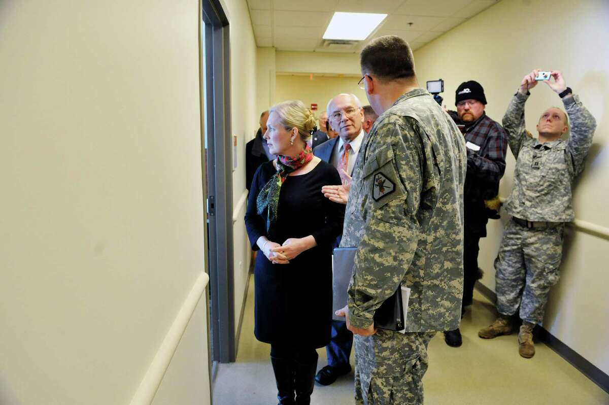 Sen. Kirsten Gillibrand, left, and Congressman Paul Tonko, center, are given a tour by Lt. Col. Chris Hanifin, commander of the 7th Legal Operations Detachment at the SSG Horace D. Bradt Army Reserve Center on Sunday, Feb. 15, 2015, in Schenectady, N.Y. As a member of the Senate Armed Services Committee Gillibrand helped to secure $20 million for the construction of the new center. (Paul Buckowski / Times Union)