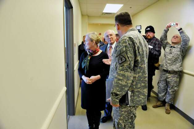 Sen. Kirsten Gillibrand, left, and Congressman Paul Tonko, center, are given a tour by Lt. Col. Chris Hanifin, commander of the 7th Legal Operations Detachment at the SSG Horace D. Bradt Army Reserve Center on Sunday, Feb. 15, 2015, in Schenectady, N.Y.  As a member of the Senate Armed Services Committee Gillibrand helped to secure $20 million for the construction of the new center.    (Paul Buckowski / Times Union) Photo: Paul Buckowski / 00030625A