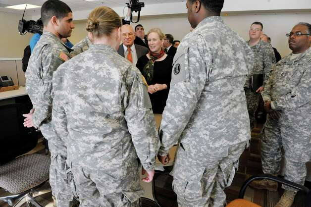 Congressman Paul Tonko, background left, and  Sen. Kirsten Gillibrand, talk with soldiers during a tour of the SSG Horace D. Bradt Army Reserve Center on Sunday, Feb. 15, 2015, in Schenectady, N.Y.  As a member of the Senate Armed Services Committee Gillibrand helped to secure $20 million for the construction of the new center.    (Paul Buckowski / Times Union) Photo: Paul Buckowski / 00030625A