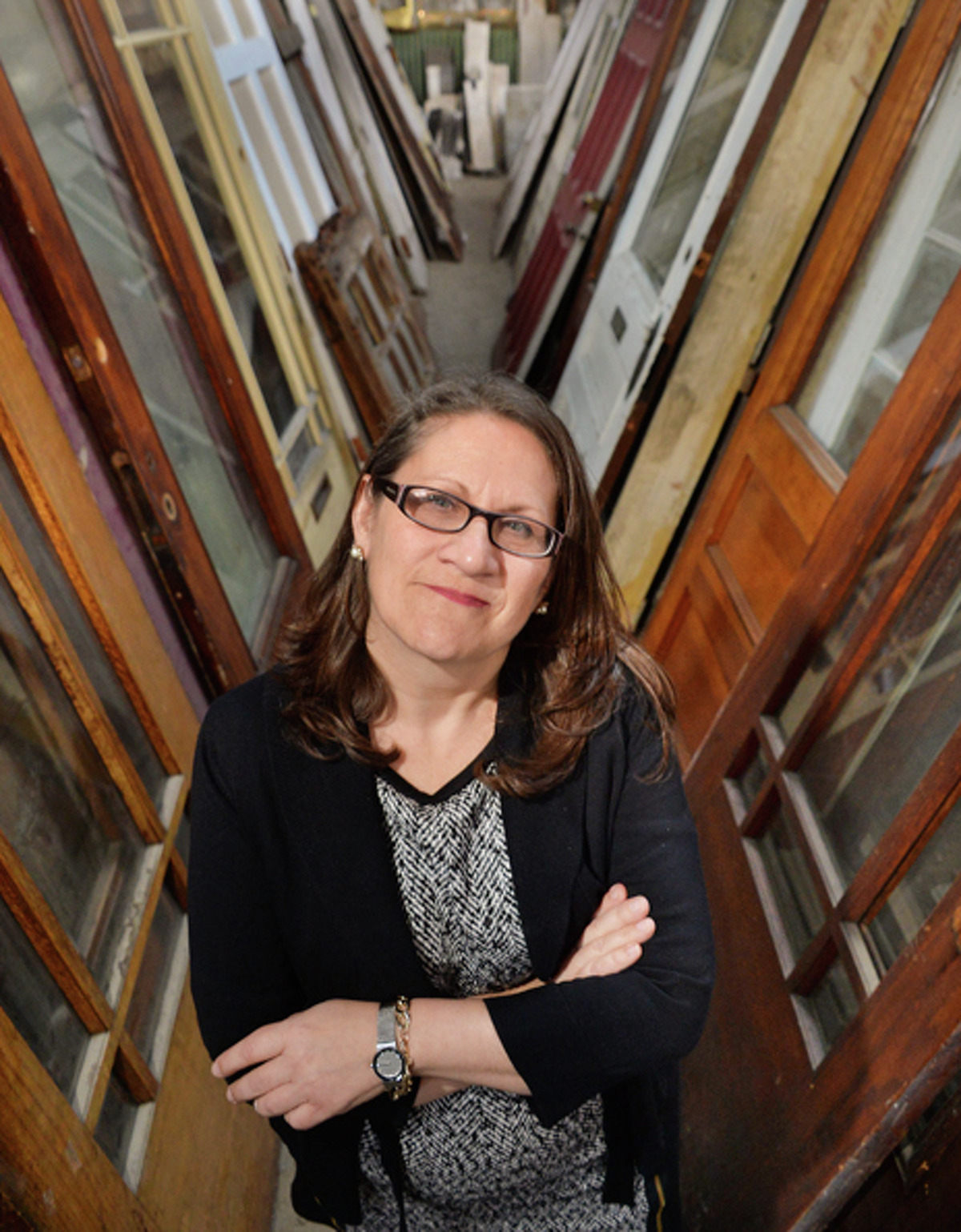 Executive director Susan Holland in an aisle of premium doors in Historic Albany Foundation's warehouse Tuesday Jan. 13, 2015, in Albany, NY.