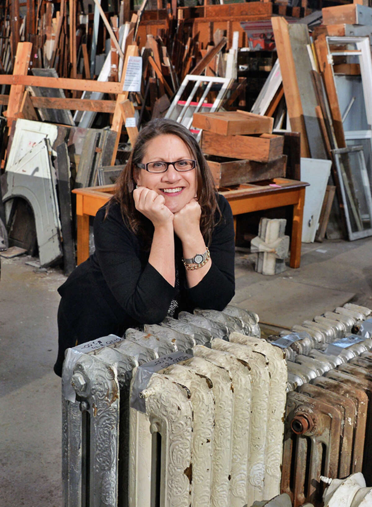 Executive director Susan Holland with cast iron steam and hot water radiators salvaged from the park South demolition now in Historic Albany Foundation's warehouse Tuesday Jan. 13, 2015, in Albany, NY.
