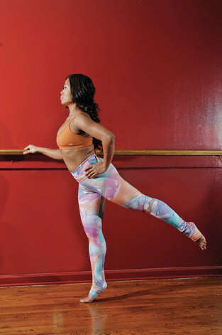 Step 3: Extend the outer leg behind you as high as you can; then bring back down at a steady pace. Do 12 reps 3 times, with 3-second rest in between. This works out your inner/back of your thighs and glutes. (Paul Buckowski / Times Union) Photo: Paul Buckowski / 518Life / 00030224A