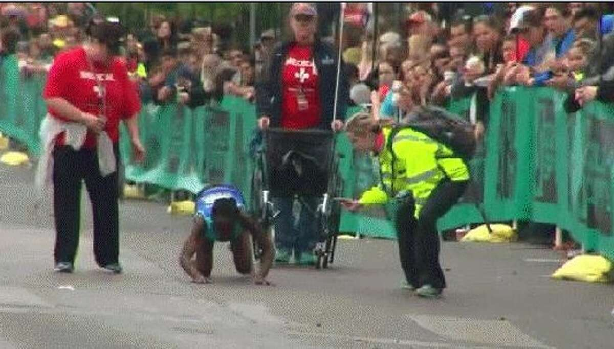 Hyvon Ngetich of Kenya fell to the ground near the end of the race and crawled the rest of the way to the finish line. She placed third for women.
