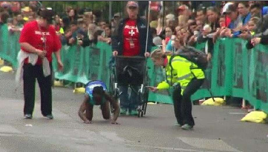 Hyvon Ngetich of Kenya fell to the ground near the end of the race and crawled the rest of the way to the finish line. She placed third for women. Photo: Courtesy Photo/NDN