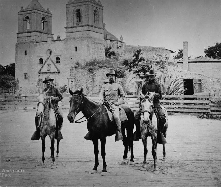 American military commander (and future U.S. President) Theodore Roosevelt (center) poses on a horse in front of San Antonio's Mission Concepción during the Spanish-American War in 1898. With him is, on the right, is Col. Leonard Wood.