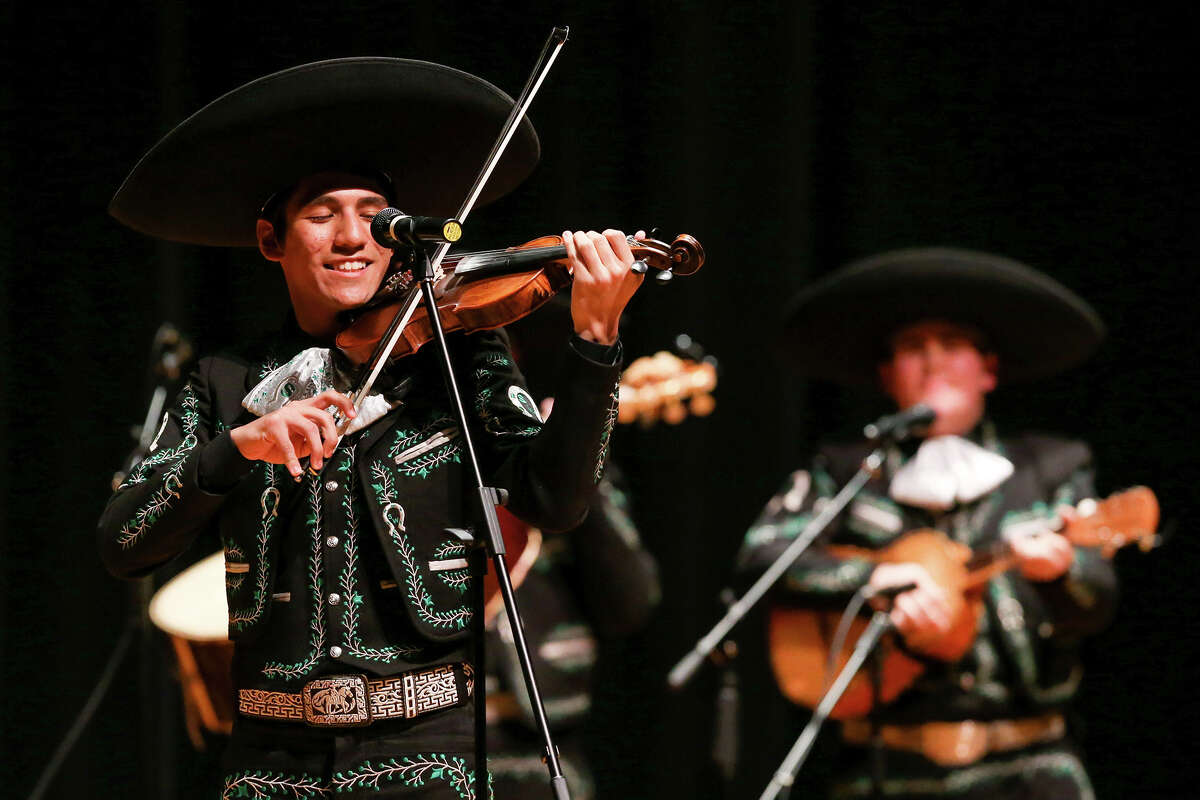 Matthew Castillo, a junior with the Southwest High School Mariachi Los Dragones, smiles as he deftly makes his bow dance on his violin during the 2015 Texas High School Mariachi Competition Finals at Southwest High School on Saturday, Feb. 7, 2015. Southwest finished fifth in this year's competition. MARVIN PFEIFFER/ mpfeiffer@express-news.net