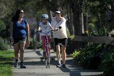 Amity Balbutin (left) strolls along the Ohlone Greenway with Alexandra Sokulsky (center), 7, and her mother, Michelle Sweeney, in Berkeley.