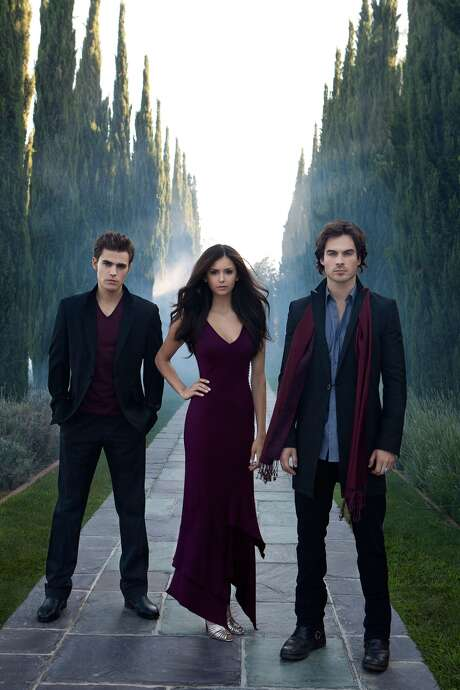 "Ian Somerhalder (right) stars with Paul Wesley and Nina Dobrev in ""The Vampire Diaries."" Photo: Andrew Eccles /TThe CW / 2009 The CW Network, LLC. All Rights Reserved."