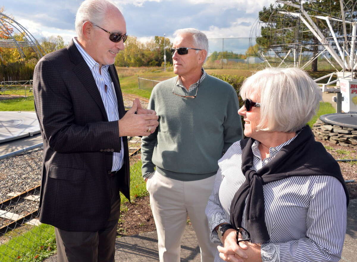 Jeffrey Sperber, left, of Huck Finn's Warehouse with Hoffman's Playland owners David and Ruth Hoffman prior to the announcement of the amusement park's move to property adjacent to Huck Finn's Warehouse in Albany during a news conference Wednesday Oct. 8, 2014, in Colonie, NY. (John Carl D'Annibale / Times Union)