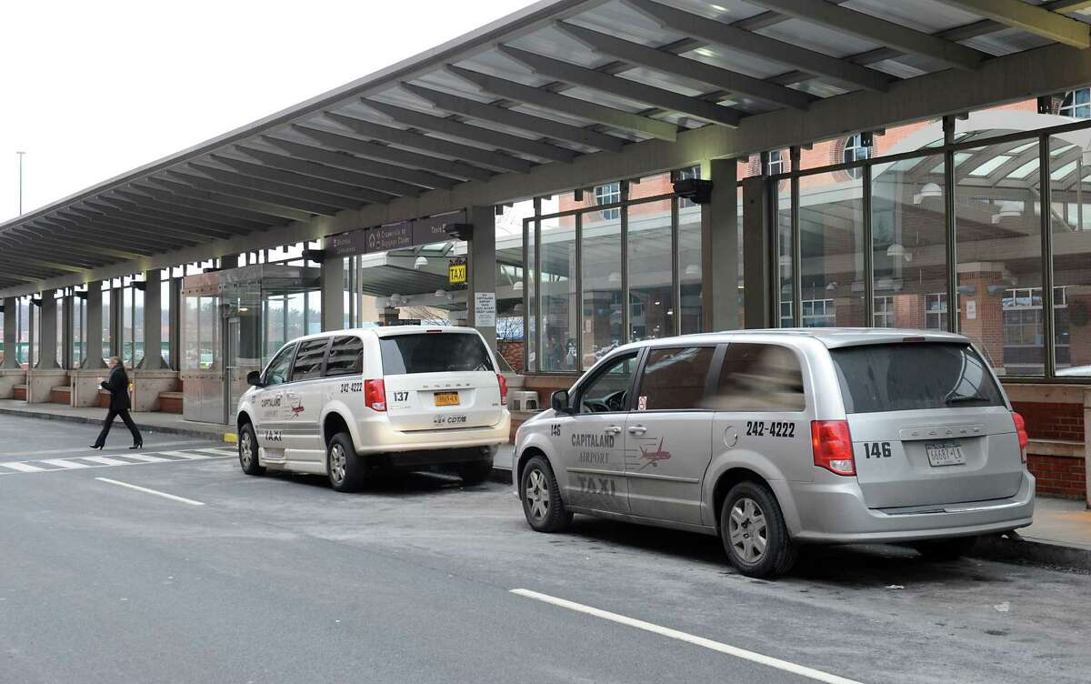 Taxis waits in front of the terminal at Albany International Airport on Monday, Dec. 15, 2014 in Colonie, N.Y. (Lori Van Buren / Times Union)