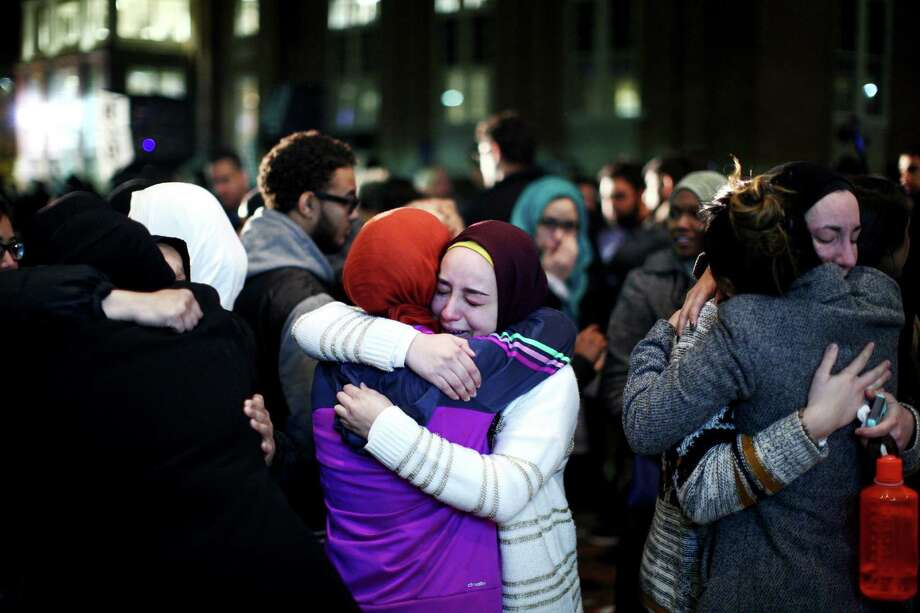 Mourners embrace during a vigil on the University of North Carolina campus for three Muslim students killed last week in Chapel Hill, N.C. A reader says that the hate evidenced by this crime is damaging the fabric of our nation. Photo: TRAVIS DOVE /New York Times / NYTNS