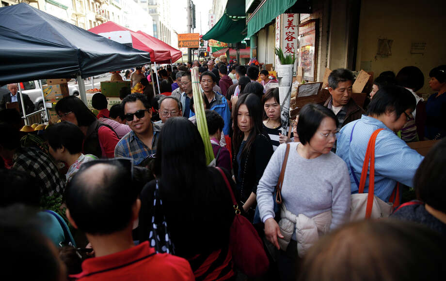 The sidewalks are crowded and hard to navigate on Stockton Street, which is the main shopping area for locals in Chinatown. Photo: Scott Strazzante / The Chronicle / ONLINE_YES