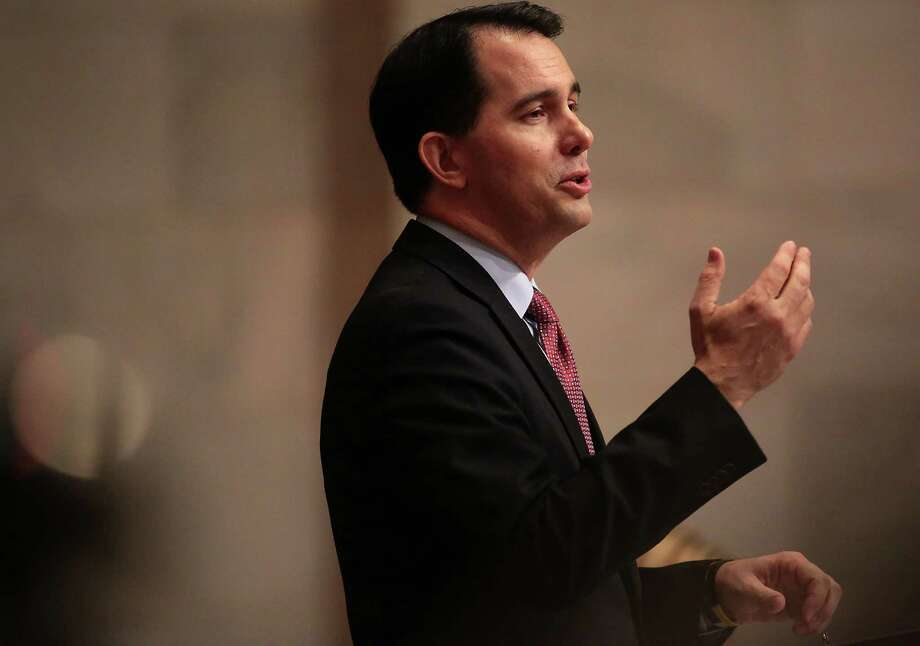 Wisconsin Gov. Scott Walker delivers his state budget address at the Wisconsin state Capitol in Madison, Wis. earlier this month. It includes a requirement that recipients of government aid submit to drug testing. Photo: John Hart /Associated Press / Wisconsin State Journal
