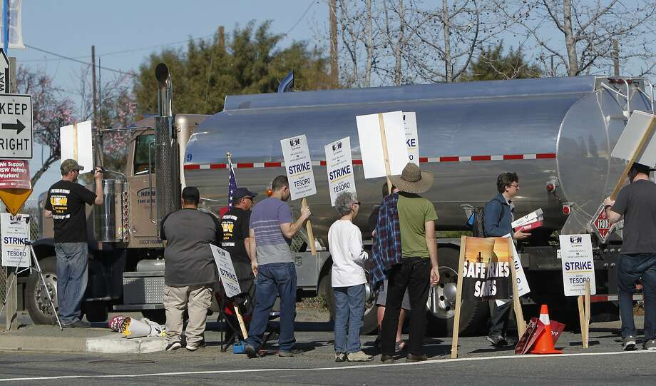 A group of United Steelworkers approach a truck crossing the picket line while protesting outside the Tesoro Golden Eagle Refinery in Martinez, Calif. Saturday, February 14, 2015. Photo: Jessica Christian, The Chronicle