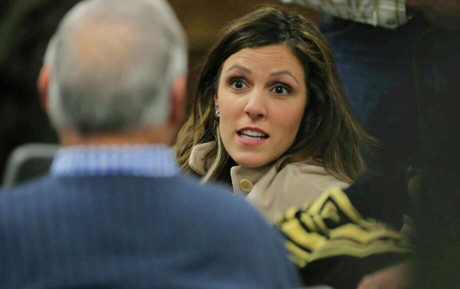 Taya Kyle, widow of Chris Kyle, talks with a supporter after lunch break during the capital murder trial of former Marine Cpl. Eddie Ray Routh at the Erath County, Donald R. Jones Justice Center in Stephenville, Texas, Monday, Feb.16, 2015. Routh, 27, of Lancaster, is charged with the 2013 deaths of former Navy SEAL Chris Kyle and his friend Chad Littlefield at a shooting range near Glen Rose, Texas.  (AP Photo/Star-Telegram, Rodger Mallison, Pool) Photo: Rodger Mallison, POOL / Associated Press / Fort Worth Star-Telegram Pool
