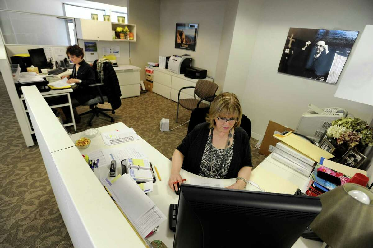 Patty Steckler, left, and Dorothy Pritchett, work at their desks at Guideposts Wednesday, March 19, 2014. Guideposts has offices at The Matrix Corporate Center in Danbury, Conn.