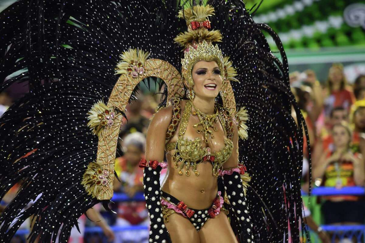 Revelers of the Salgueiro samba school perform during the first day of carnival parade at the Sambodrome in Rio de Janeiro, Brazil on Feb. 16, 2015.