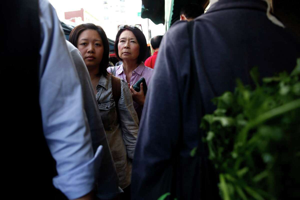 The sidewalks are crowded and hard to navigate on Stockton Street, which is the main shopping area for locals in Chinatown.