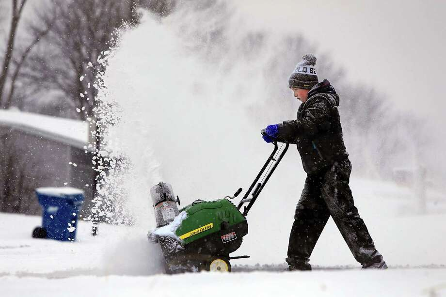 """Connor Williams, 11, operates a snowblower for the first time on Monday, Feb. 16, 2015, as he helps his grandmother, Linda Wililams, clear her driveway in Maryland Heights, Mo. """"He'll spray you if you're not carefull,"""" said Linda Williams. (Christian Gooden/St. Louis Post-Dispatch/TNS) Photo: Christian Gooden, MBR / McClatchy-Tribune News Service / St. Louis Post-Dispatch"""