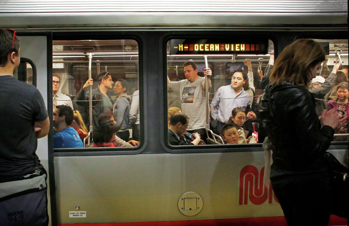 During the Friday evening commute, Muni riders pack an inbound M-line light rail train in San Francisco.