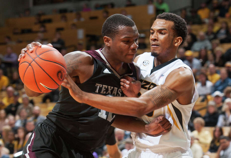 Texas A&M's Jalen Jones, left, pushes into Missouri's Jakeenan Gant, right, as he drives to the basket during the second half of an NCAA college basketball game Saturday, Feb. 7, 2015, in Columbia, Mo. Texas A&M won the game 83-61.(AP Photo/L.G. Patterson) Photo: L.G. Patterson, FRE / Associated Press / FR23535 AP