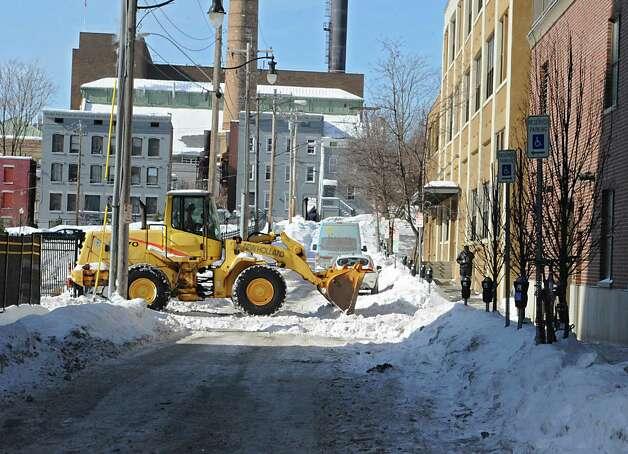 A tractor clears snow on Monroe St. on Monday, Feb. 16, 2015 in Albany, N.Y. (Lori Van Buren / Times Union) Photo: Lori Van Buren / 00030636A