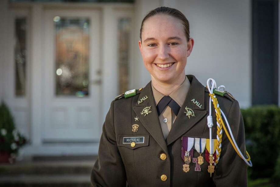 The parents of another ground-breaking Texas A & M graduate saluate Alyssa Marie Michalke of Schulenburg, Texas, the first female leader of the Corps of Cadet at the university. Photo: Matt Willis /Courtesy Photo / Texas A&M University