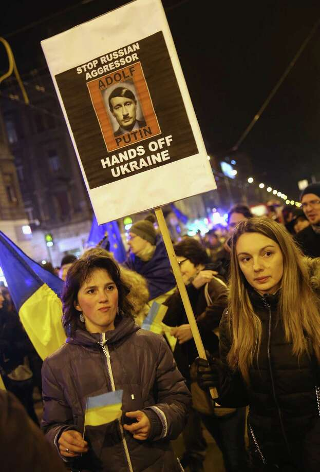 Demonstrators in Budapest, Hungary, bearing Ukrainian flags, march to protest Russian President Vladimir Putin as well as against the government of Hungarian Prime Minister Viktor Orban, who has been seeking closer ties with Russia. Photo: Sean Gallup, Staff / 2015 Getty Images