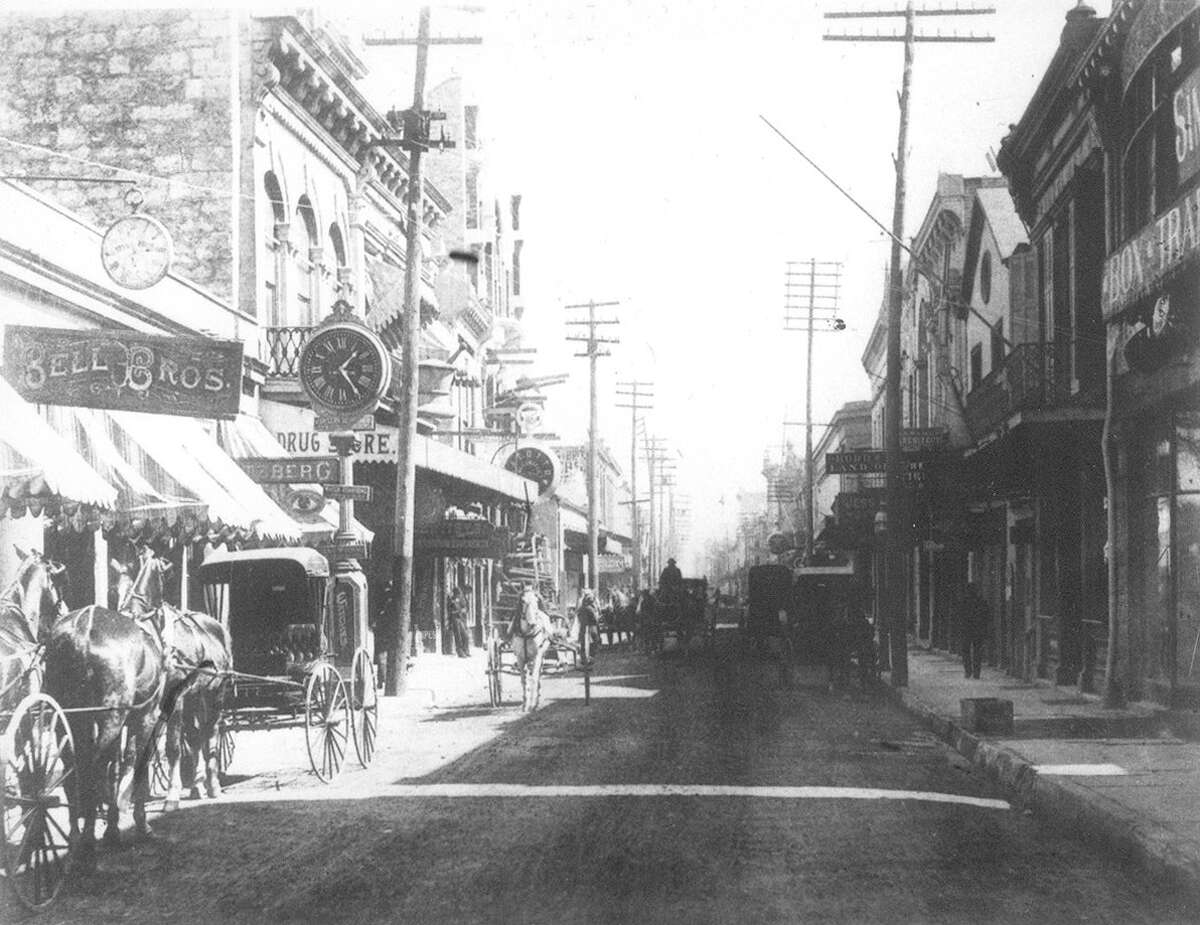 The Hertzberg Clock can be seen in this view of Commerce Street, east from the Kampmann Building, in a photo taken sometime before 1910.