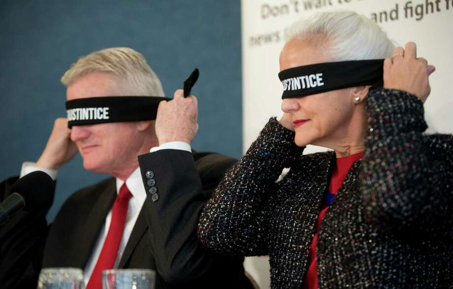 Debra and Marc Tice, parents of freelance journalist Austin Tice, blindfold themselves at the National Press Club in Washington last week in an effort to raise awareness of their son's disappearance in Syria in 2012. Photo: Pablo Martinez Monsivais, STF / AP