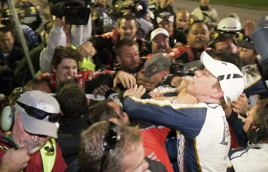 Brad Keselowski, right, is involved in a melee between his team and Jeff Gordon's crew after a NASCAR Sprint Cup race at Texas Motor Speedway on Nov. 2. Photo: Matthew Bishop, FRE / AP
