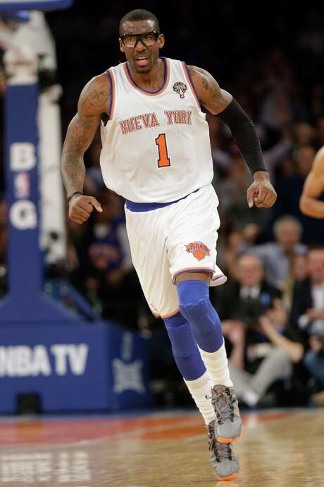 New York Knicks' Amar'e Stoudemire (1) reacts after scoring during the second half of an NBA basketball game against the Oklahoma City Thunder Thursday, March 7, 2013, in New York. The Thunder won the game 95-94.  (AP Photo/Frank Franklin II) Photo: Frank Franklin II, STF / AP