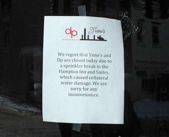 A sign is posted in the door of Yono's restaurant where a pipe burst causing flooding on Monday, Feb. 16, 2015 in Albany, N.Y. (Lori Van Buren / Times Union) Photo: Lori Van Buren / 00030638A