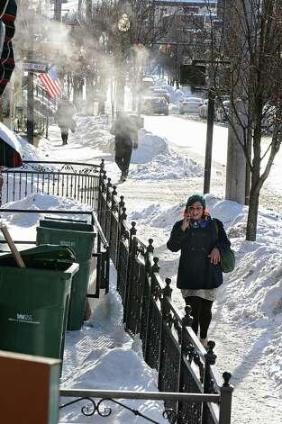 Pedestrian walk down Lark St. in freezing temperatures on Monday, Feb. 16, 2015 in Albany, N.Y. (Lori Van Buren / Times Union) Photo: Lori Van Buren / 00030636A