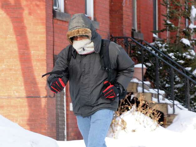 A man walks along Dove St. in freezing weather on Monday, Feb. 16, 2015 in Albany, N.Y. The man did not want to give his name. (Lori Van Buren / Times Union) Photo: Lori Van Buren / 00030636A