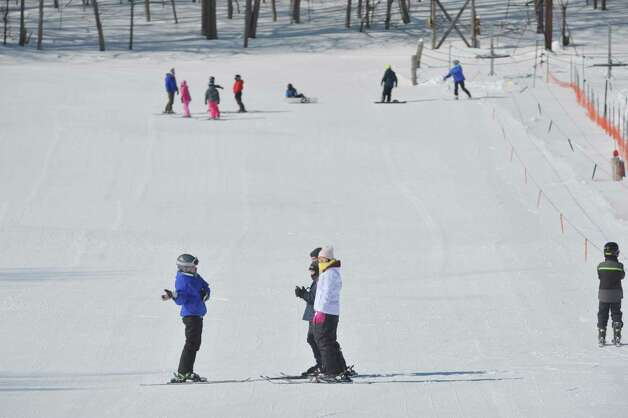 Children in the  Maple Ski Ridge February Vacation Skiing or Snowboarding Program work with their instructors at the ski hill on Monday, Feb. 16, 2015, in Rotterdam, N.Y.  The ski hill offers a full day program from 8:30am to 3pm during the school break.  The ski hill is also holding the Snow Box Derby on February 21st.  (Paul Buckowski / Times Union) Photo: Paul Buckowski / 00030357A