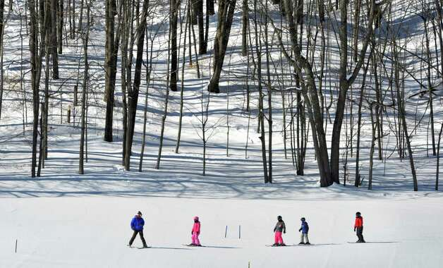 A group of children in the  Maple Ski Ridge February Vacation Skiing or Snowboarding Program follow their instructor at the ski hill on Monday, Feb. 16, 2015, in Rotterdam, N.Y.  The ski hill offers a full day program from 8:30am to 3pm during the school break.  The ski hill is also holding the Snow Box Derby on February 21st.  (Paul Buckowski / Times Union) Photo: Paul Buckowski / 00030357A