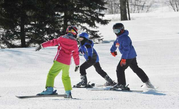 Children in the  Maple Ski Ridge February Vacation Skiing or Snowboarding Program practice their skills at the ski hill on Monday, Feb. 16, 2015, in Rotterdam, N.Y.  The ski hill offers a full day program from 8:30am to 3pm during the school break.  The ski hill is also holding the Snow Box Derby on February 21st.  (Paul Buckowski / Times Union) Photo: Paul Buckowski / 00030357A