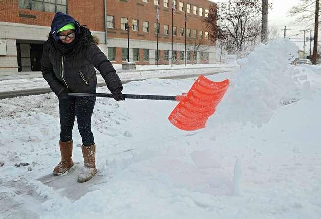Lynette Leone shovels the sidewalk in front of her home on Lark St. on Monday, Feb. 16, 2015 in Albany, N.Y. (Lori Van Buren / Times Union) Photo: Lori Van Buren / 00030636A