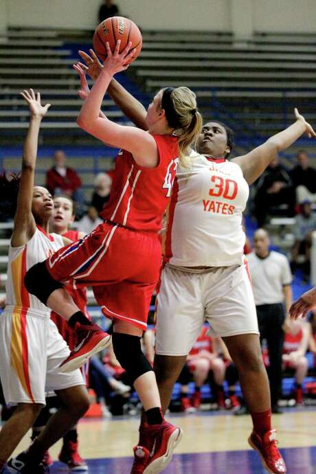 Tomball's Bethany Petch (42) takes a shot as Yates' Keyana Mack (30) defends during the second half of the Cougars' shocking upset win last weekend. Photo: J. Patric Schneider, Freelance / © 2015 Houston Chronicle