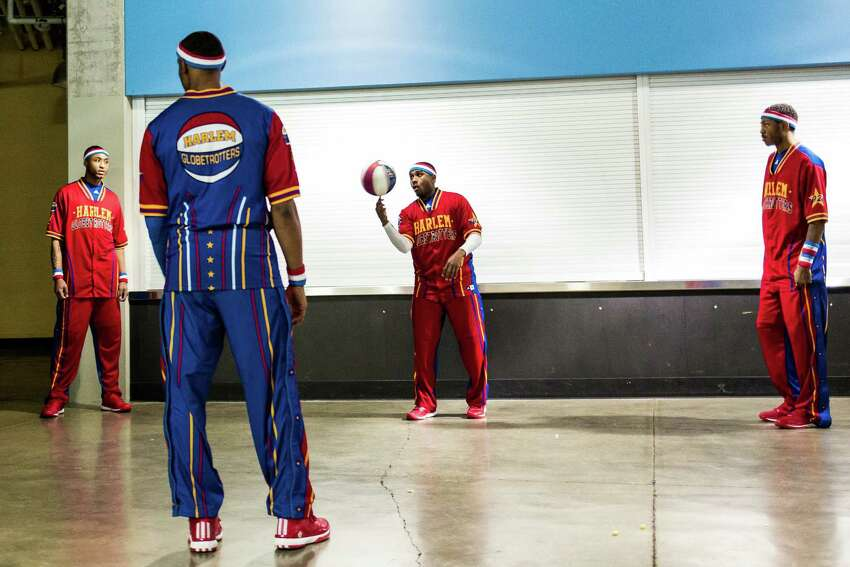 Harlem Globetrotters warm up backstage before taking on the Washington Generals Monday, February 16, 2015, at the XFINITY Arena in Everett, Washington. Families from around the region flocked to Everett to enjoy incredible ball handling wizardry, trick shots and plenty of hardwood comedy.