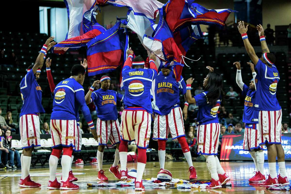 Tear-off warm up pants rain down on the iconic Harlem Globetrotters before facing off against the Washington Generals Monday, February 16, 2015, at the XFINITY Arena in Everett, Washington. Families from around the region flocked to Everett to enjoy incredible ball handling wizardry, trick shots and plenty of hardwood comedy.