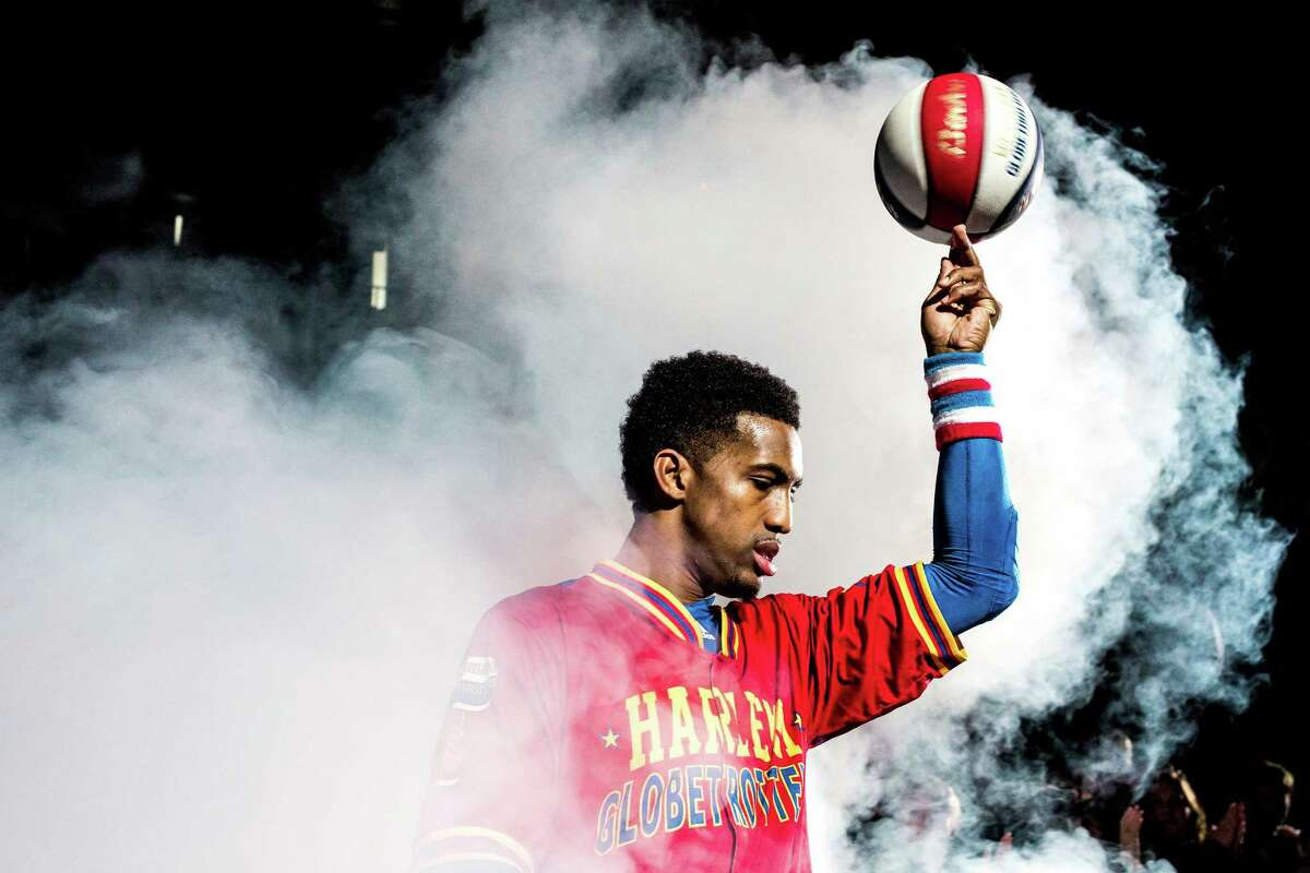 Players from the Harlem Globetrotters emerge into the arena in a cloud of smoke before taking on the Washington Generals Monday, February 16, 2015, at the XFINITY Arena in Everett, Washington. Families from around the region flocked to Everett to enjoy incredible ball handling wizardry, trick shots and plenty of hardwood comedy.