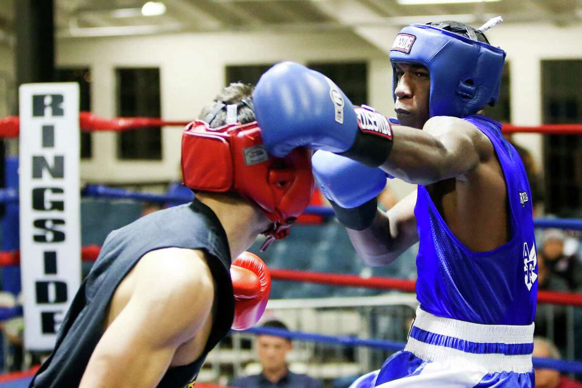 Kamryn Dungy (right) fighing with the USAF, fights Bryan Vasquez, unattached, during opening night of the 2015 San Antonio Regional Golden Gloves boxing tournament at Woodlawn Gym on Monday, Feb. 16, 2015. MARVIN PFEIFFER/ mpfeiffer@express-news.net